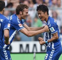KARLSRUHE, GERMANY - SEPTEMBER 21:  Hiroki Yamada (R) of Karlsruhe celebrates with his team-mates after scoring his team's first goal duringduring the Second Bundesliga match between Karlsruher SC and 1. FC Nuernberg at Wildpark Stadium on September 21, 2014 in Karlsruhe, Germany.  (Photo by Matthias Hangst/Bongarts/Getty Images)